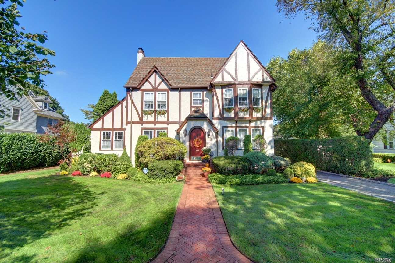 Mint Ctr Hall Tudor Style Colonial. Spacious, Offers Lge Cath Ceiling Fam Rm W/Fr Drs Leading To Lge Paito W/Pond & Pvt Landscaped Bkyard, Sunroom/Office, Gran Eik, Lge Fdr, Lge Lr W/Gas Frplc, 2nd Flr W/4Brs, Mbr W/Mstr Bth. 3rd Flr W/2Brs, Fbth, Fin Bsmt W/Lots Of Closet Space & Storage. Hdwd Flrs , 2 Car Det Gar, Igs, Low Taxes, Great Curb Appeal, Friendly Neighborhood.