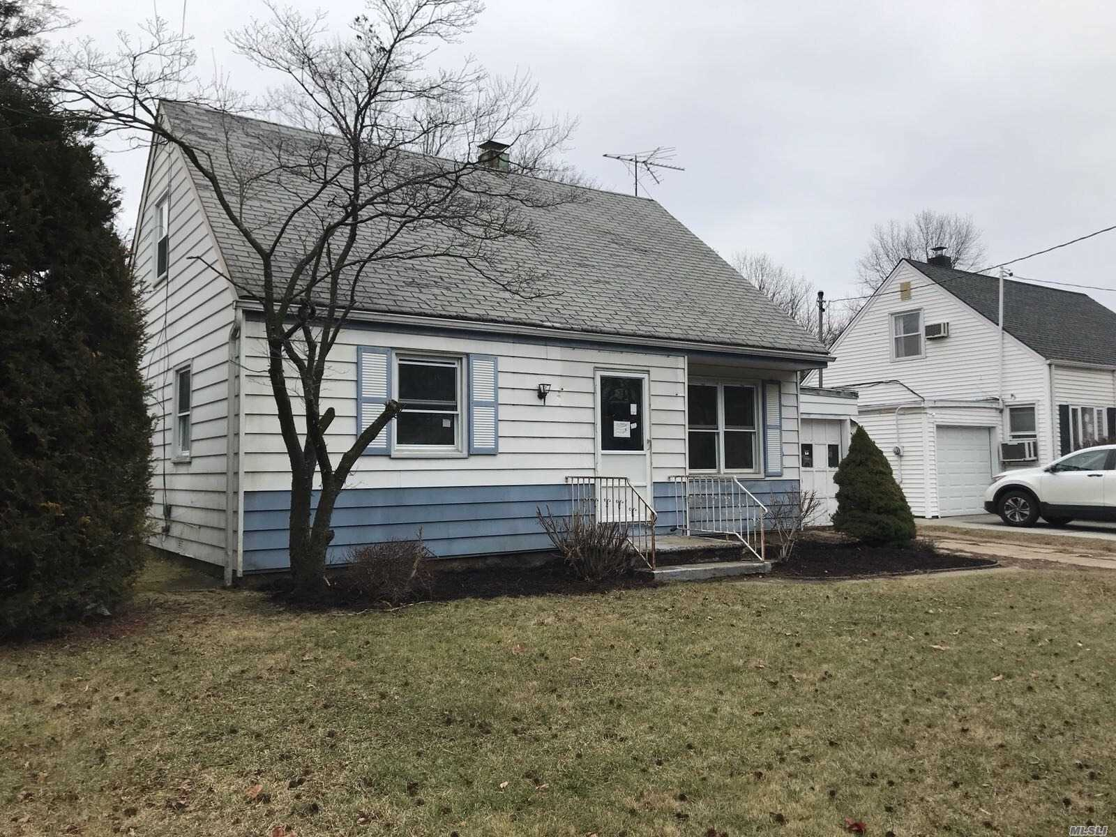 Detached Single Family Cape With An Attached One Car Garage. First Floor Consists Of Living Room/Dining Room Combo, Kitchen, Two Bedrooms And One Full Bathroom. Close To Schools, Churches, And Transportation.