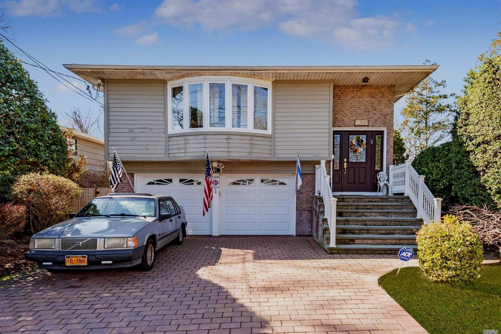 Beautiful All Updated H/R. Ideal For Mo/Dau (Permit Required). Windows And Doors All Replaced.Incl Garage Doors. Bathrooms Redone. Radiant Heat In Eik. Hw Flrs In Lr, Dr And Brs. All Stone Driveway, Walkway And Stairs To Front Door.Certified Green Features Incl Top Of The Line Gas Heating And Fujitzer Ductless Ac . Fabulous 14'X16' Sunroom With Silding Doors . Move Right In.