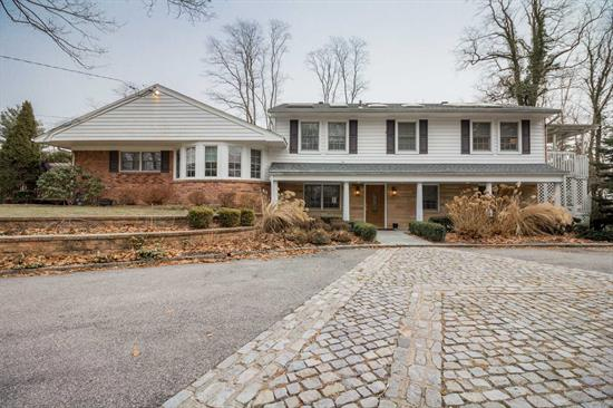 A Rare Find, Post Modern Home, 5-6 Bedrooms, 3 Updated Bedrooms, French Doors To Decks & Pavers To Firepit, Pool, Waterfall, Gourmet Kitchen W/Radiant Floors, 2Fpl's, On 1 Acre Lush Landscaped Property In The Acclaimed Harborfields School District. Taxes In Process Of Being Grieved. Convienent To All. A Must See!