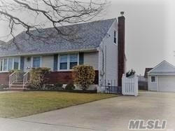 Beautiful Wide-Line Cape Home Featuring Spacious Eat In Kitchen, 4 Bedrooms, Huge Private Yard Ideal For Entertaining. Full Finished Basement With Separate Work Room & Laundry Room. Roof Is Less Than 10 Years Old!