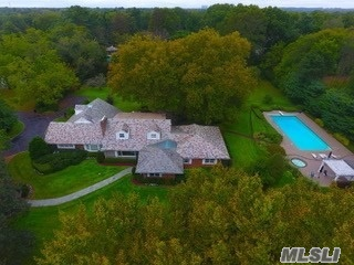Old Westbury. Excellent Expanded 7 Bedroom, 5.5 Bath Ranch. Traditional Living Room With Fireplace, Den With Fireplace, Eik,  Large Gym, Finished Basement With Door Out, Brick/Shingle Home With Slate Roof. Exquisite Flat, Usable And Professionally Landscaped 2.2 Acres With Ig Gunite Pool And Cabana With Kitchen And Changing Rooms And Large Entertainment Patio.