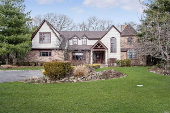 Spectacular Tudor Style Colonial Completely Rebuilt And Expanded In 2007. Perfect Midblock Location Backing 400 Acre Preserve. Expanded Gourmet Kitchen, Hardwood Floors, All New Windows, New Roof, Expanded Master Suite With 2 Fireplaces. Expanded Family Area With 4 Bedrooms And 2 Baths. Finished Basement, Whole House Generator.Taxes Being Grieved. Syosset Schools