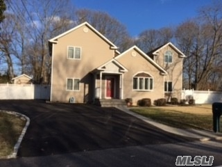 Totally Re-Done Large Colonial In Comsewogue. Whole House Updated 12 Years Ago With Granite Kitchen And Glass Backsplash, Hw Throughout Whole House, Large Lr With French Doors To Back, Den With Ose, 4 Bdrms And Computer Room. 3/5 Baths Like New. Low, Low Taxes $ 7984 W/O Exemption. Backyard Has Bb Court With Oval Cement Track For Bike Riding. Landscaped, Private, Fenced.