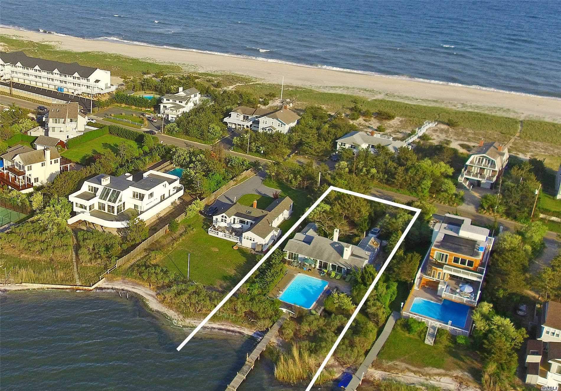 Great Rental Track Record For This Very Private Bay Front Home On Dune Road Offers Living Room, Dining Area, Updated Kitchen, Two Master Bedrooms With Baths, 2 Additional Guest Rooms And 2 Additional Full Baths, Pool. Private Walkway Steps To Ocean Beach. It Offers Extremely Rare Privacy On Dune Road Front And Back, A Boat Dock In Your Backyard. Watch The Sun Set From Your Own Private Beach On The Bay!