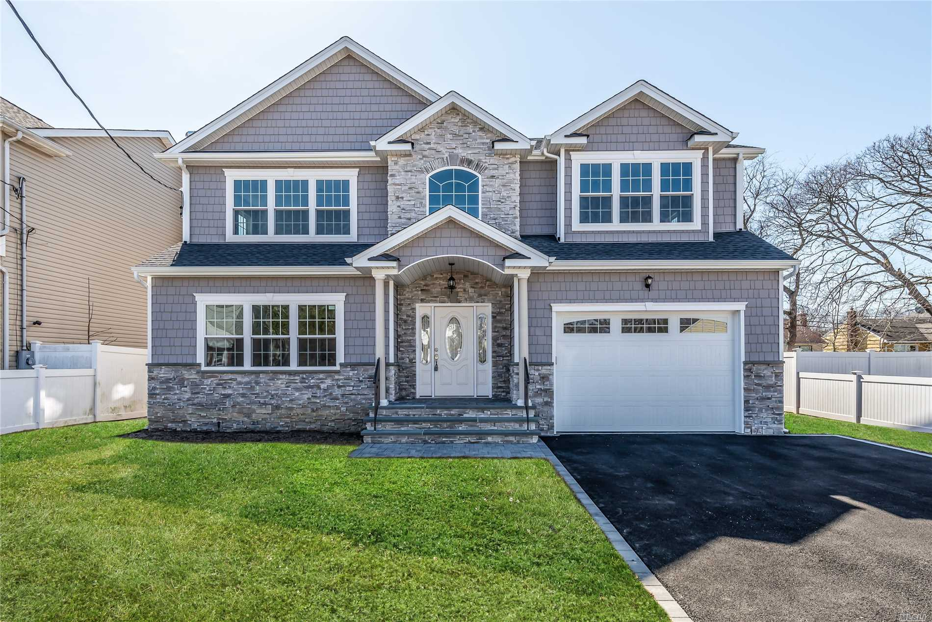 Stunning 4 Bedroom 2.5 Bath New Construction Colonial! Quality Build! Spacious Open Floor Plan, Gourmet Eat In Kitchen W/Stainless Steel Appliances, Wood Floors Throughout, Den W.Fireplace, 9 Foot Ceilings On 1st Fl, 8Ft Ceilings On 2nd Fl & Basement! Laundry Hookup On 2nd Fl. Energy Star Efficient Home!
