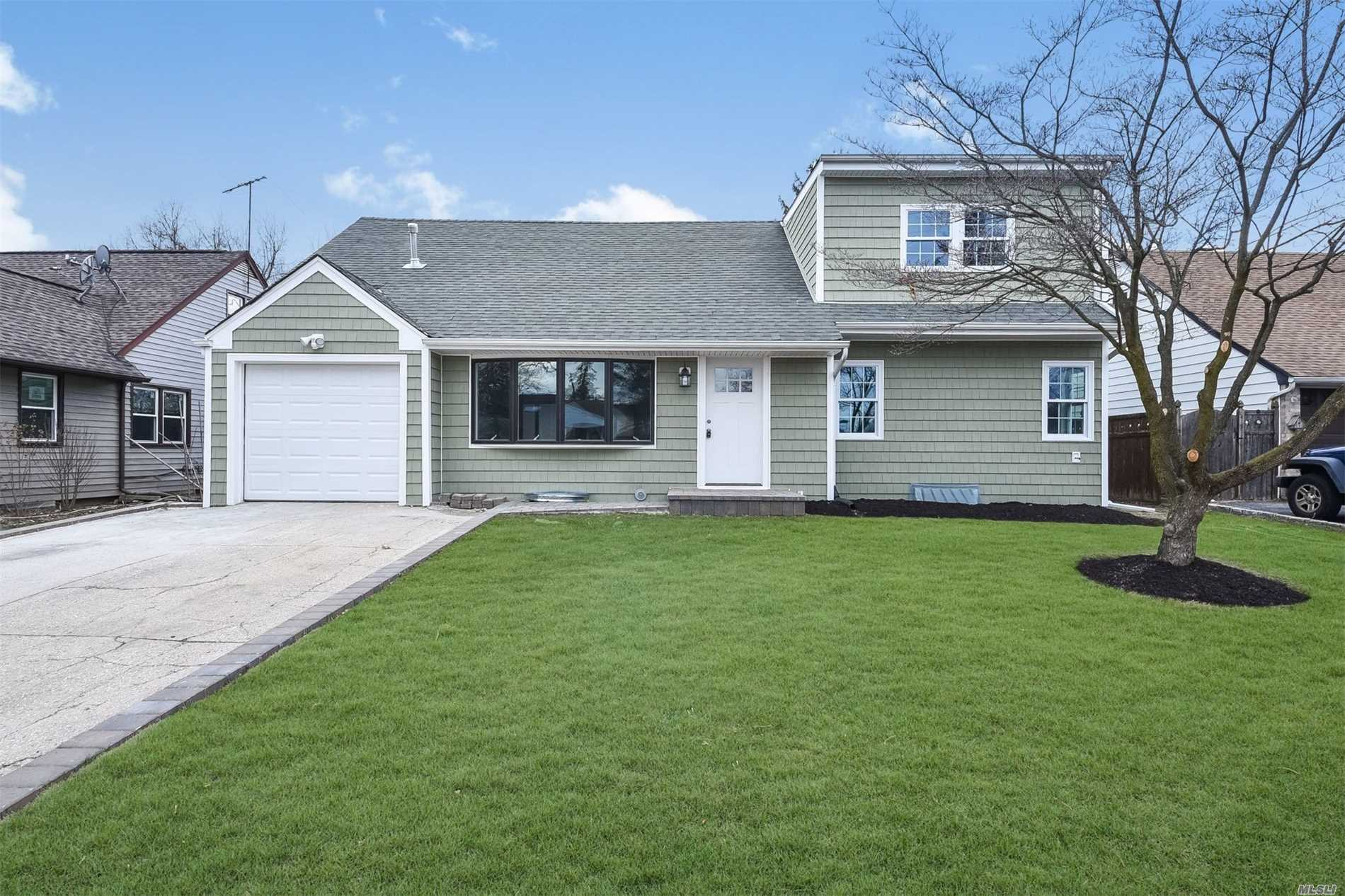 Fully Renovated 5 Bedroom 2 Full Bath. Move In Condition On A 61X100 Lot. New Andersen Windows, Beautiful Oak Floors, White Cabinets With Granite Countertops.Close To All!