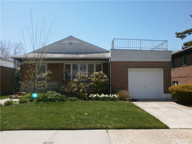 Totally Upgraded  With Granite Countertop And Floors,  Modern Baths , Hardwood Floors,  New Windows,  New Central Air.