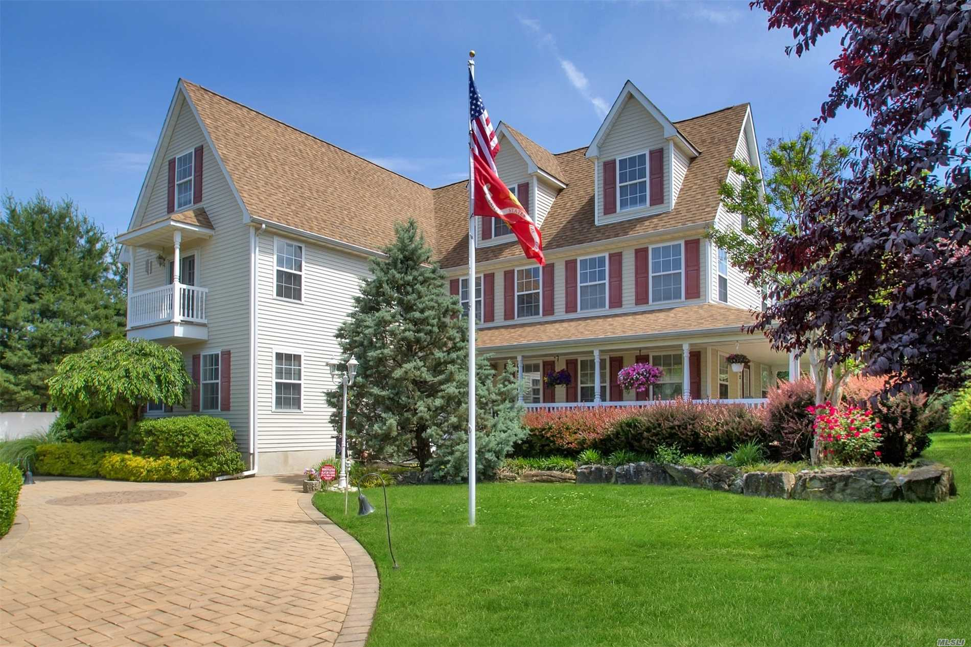 This Beautiful Custom Built 4250 Sqft.Home With Architectural Details Throughout! Specially Customized Open Floor Plan Modifications. Built As 3 Berm With Oversized Mastr Br Suite. Optional 4th Br/Office On The Fin. 3rd Floor. This Home Offers Newly Re-Built Full Wrap Around Porch, Gourmet Eik, Hardwood Floors Throughout! Must See To Appreciate!! Many More Updates! Reduced From 879000!!!