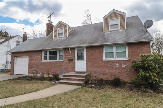 Dormered Expanded Cape With New Eat In Kitchen. Living Room Has A Warm And Cozy Fireplace. 2 Full Baths. Beautiful Mahogany Wood Floors Throughout. Wood Deck Leads To Brick Patio And Large Private Yard. Full Finished Basement With High Ceiling And Separate Entrance To Backyard. New Windows. Great Buy In North Merrick!