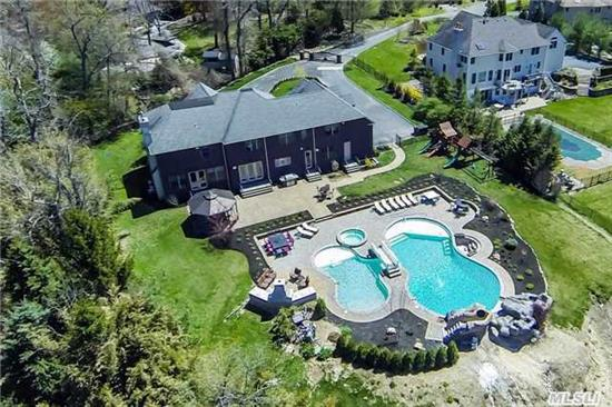 Estate Living In Dix Hills.Drive Through Private Gates Leading To Stately Brick Colonial Renovated In 2014. No Expense Spared In This Ultimate Entertainer's Delight. Resort Backyard Boasts Lagoon Shaped Pool W/ Swim-Up Bar, Hot Tub, Lounge & Outdoor Fireplace.All You Would Expect In Grand Living.Gold Coast Lifestyle In Dix Hills.When Only The Best Will Do!Too Much To List