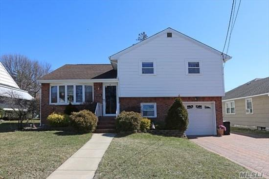 A Truly Must See Split Level Home!Spectacular From Exterior To Interior!Beautiful Kitchen(Cooking Gas) With High Ceiling And Skylight. 4 Bedrooms And 2 Full Bathrooms.Finished Basement. Home Could Be Set As Mother -Daughter With A Proper Permits(Separate Entrance).Huge Yard With Beautiful Porch. This Is Your Home! Make A Offer Now....