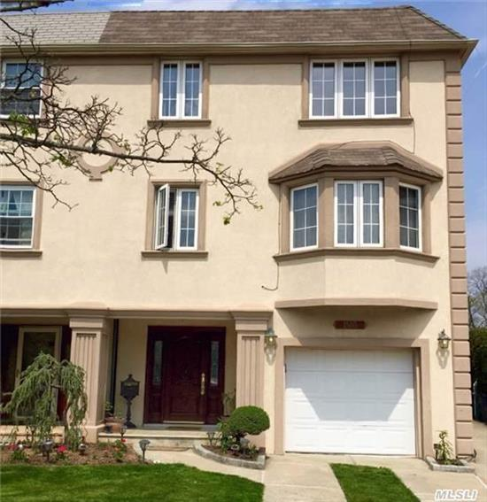 Beautiful 2 Family Semi-Detached Stucco Home In Bay Terrace. Features 4 Bdrm, 3 Bth Triplex And A 3 Bdrm, 2 Bath Duplex. Updates Include Windows, Cac, Beautiful Wood Floors, Chef's Kitchen With Ss Appliances New Baths, Gas Heat, Sep Hw Heater Ig Sprinklers. Too Much To List. Must See! Close To All.
