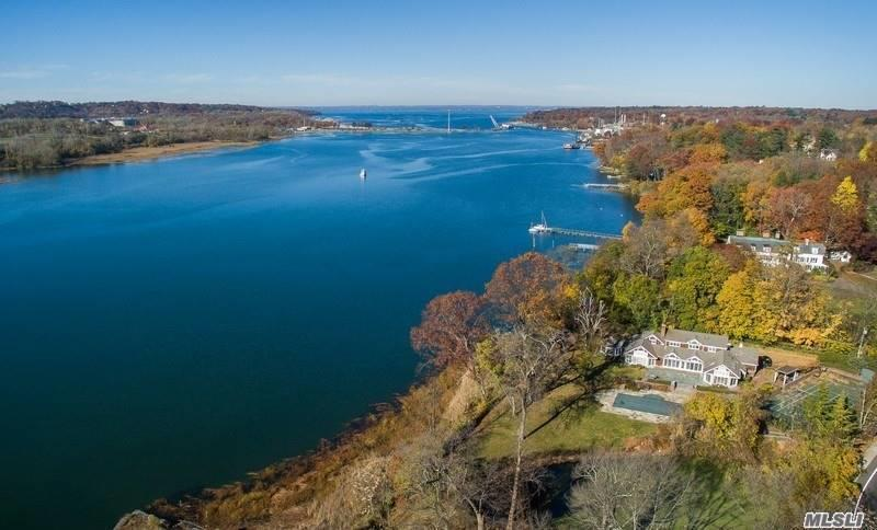 Rare Roslyn Harbor Waterfront. Unique Retreat Sprawling Over 2 Shy Acres With Breathtaking Harbor Views.This Extraordinary Home Includes A Main Floor Master Suite With Adjacent Office And Gym With French Doors Leading To Private Patio. Home Generator, Scenic Pond. Amenities Include Har-Tru Tennis Court, Heated Gunite Pool With Fully Equipped Cabana. Roslyn School District.