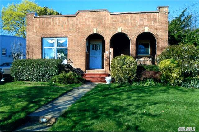 Loaded With Charm, This Well Located Brick Gables Ranch With Beautiful Hardwood Floors, Updated Kitchen And Bath, Large Sunlit Formal Dining Room, Living Room With Unique Fireplace, Full Basement Partially Finished With Bath, All New Windows, Conveniently Located Near Rr And All Shopping. A Must See.