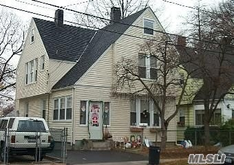 Bring The Whole Family To This Large Colonial Home With 4 Bedrooms And 2 Full Baths With Large Dining Room, Nice Size Backyard.... Low Taxes... Rare Find