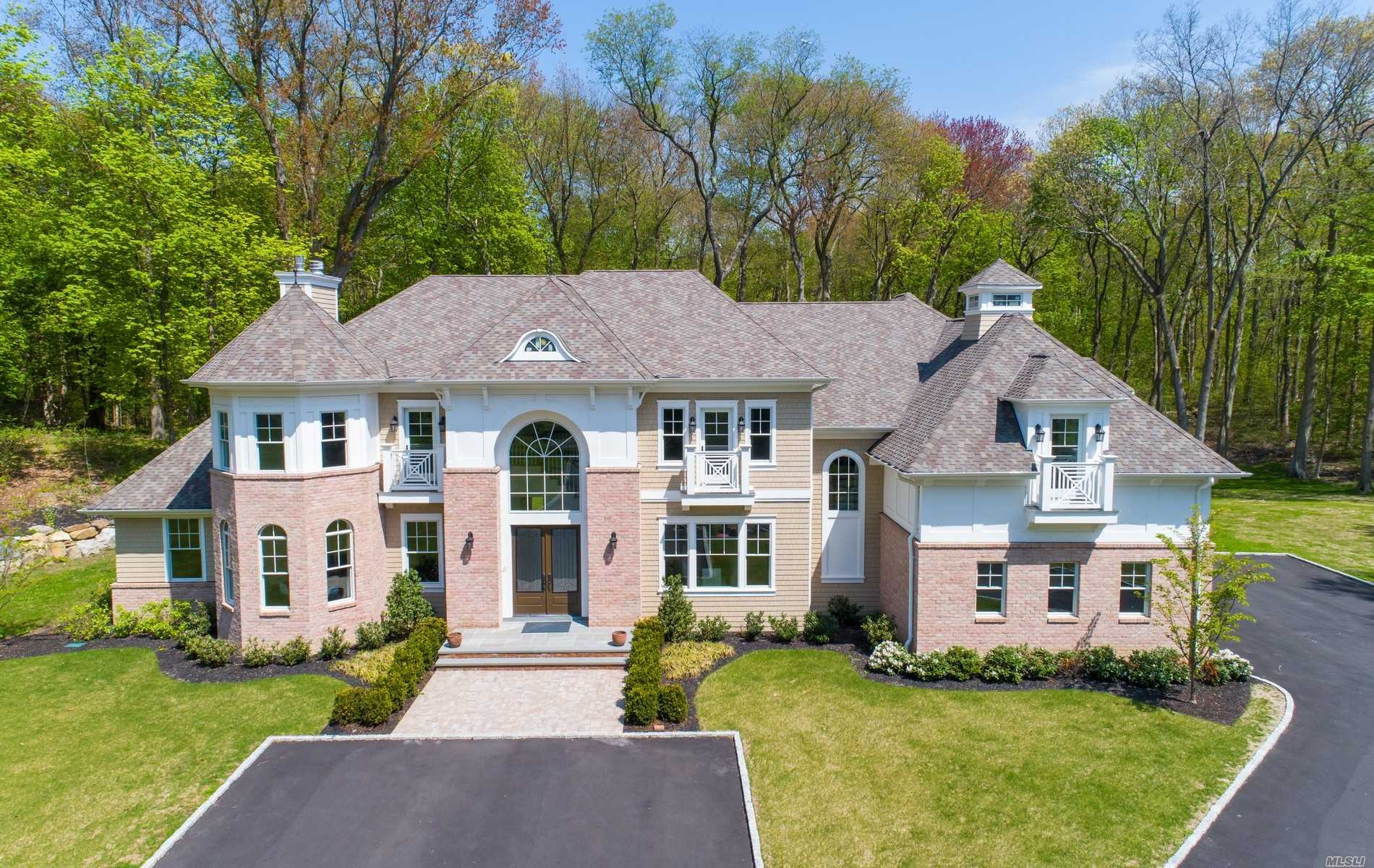 Spectacular New 6600Sqft Brick & Shingle Colonial In Famed Jericho Sd Combines Highest Quality Construction & Materials With A Refreshingly Modern & Transitional Design. Beautiful Trim And Moldings Compliment Every Room Of This Sunlit Gem. Features Include A Stunning 20' Foyer W Carrara Marble Floor, 10' Ceilings 1st Floor, 9' Ceilings 2nd Floor, 10 Ceilings Lower Level With Walk-Out, 5'' Oak Floors Throughout, Generously Proportioned Principle & Private Rooms.Set On Serene 2 Acres, 3 Car Garage