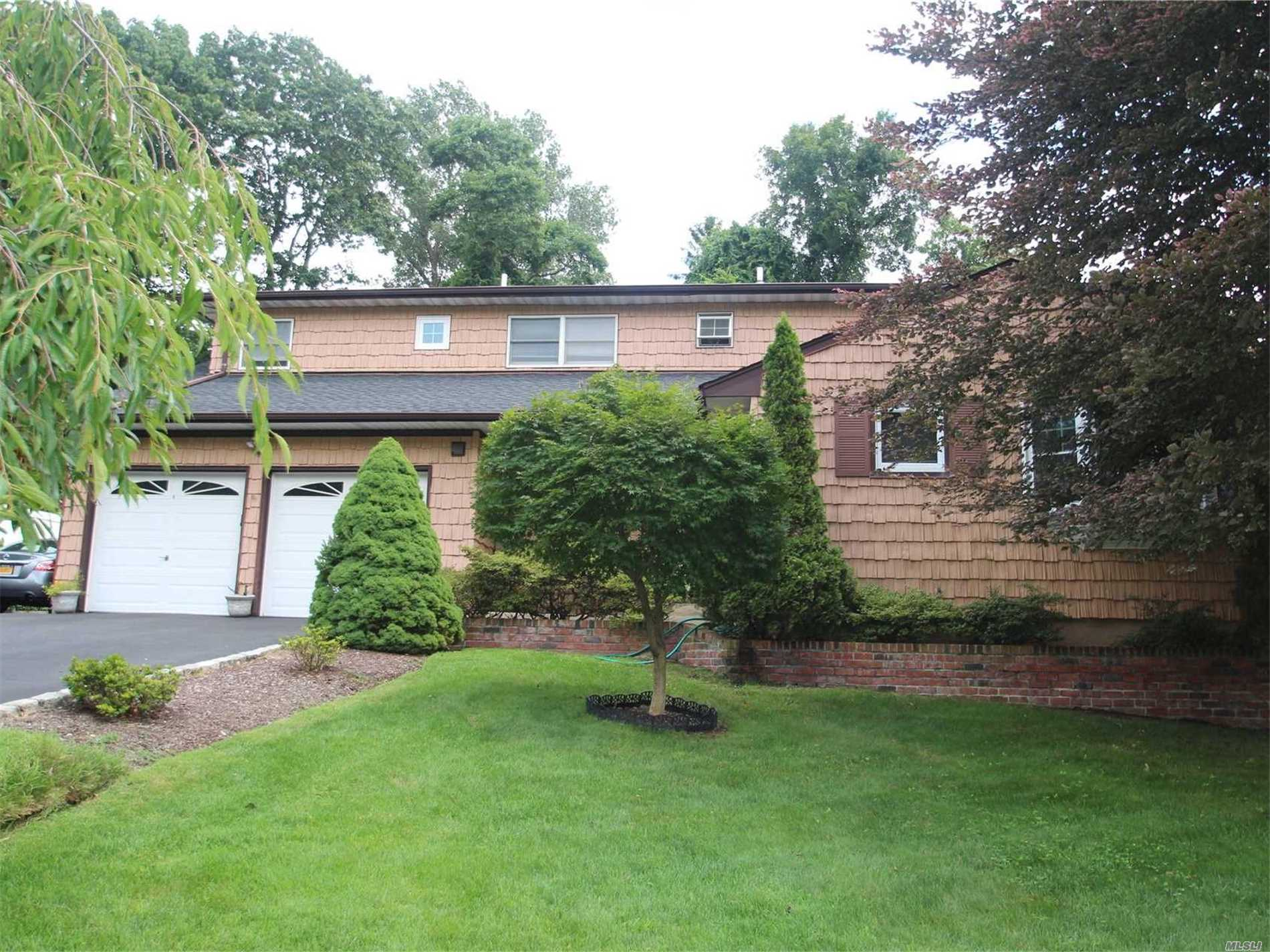 Back On The Market! Don't Miss This Excepcional Colonial On Cul-De-Sac. Posible Mother Daughter W/Proper Permits. Updates Include Kitchen, Roof, 2 Baths And Finished Basement, Secluded Yard Perfect For Entertain. Living R W/Fireplace And Sliders To Yard . Close To Sunken Meadow Park Beaches, Sshops And Railroad