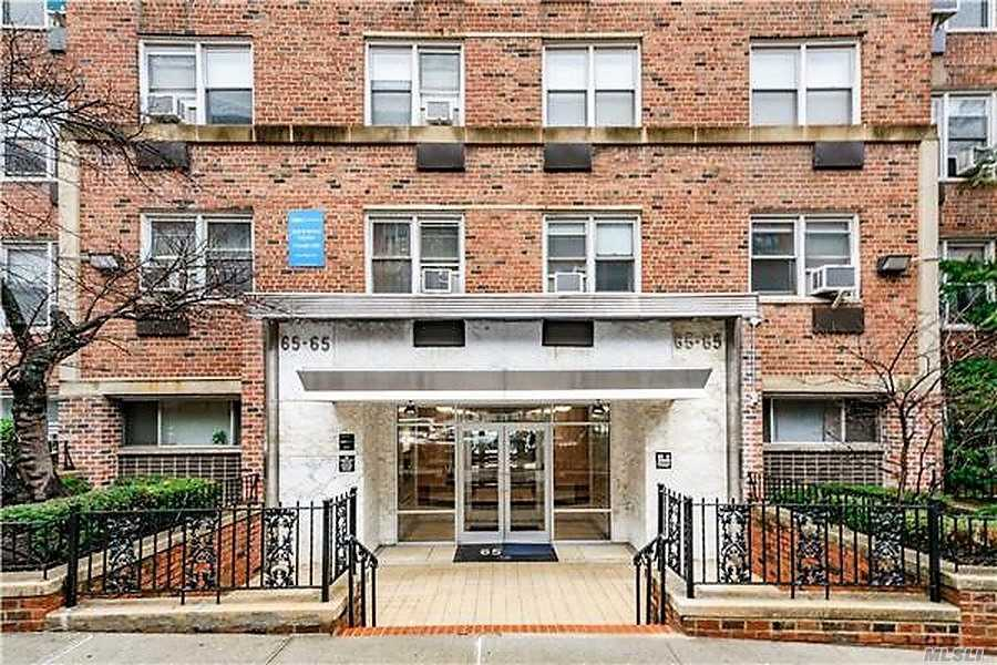 Spacious Jr-4 1.5 Bedroom! Doorman Building. Spacious Living Room. Huge Master Bedroom With Two Exposure Eastern & Northern Sides. 1/2 Bedroom & Bathroom With Ceramic Tile. Wall To Wall Beautiful Hard Wood Floors Throughout. Windows In Every Room. Plenty Of Closet Space. 2 Subway Stations (M, R) 63rd Drive & 67th Ave With In 5-10 Min Walking Distance. Q60 Bus To Manhattan. Major Retailers And Malls In The Neighborhood.