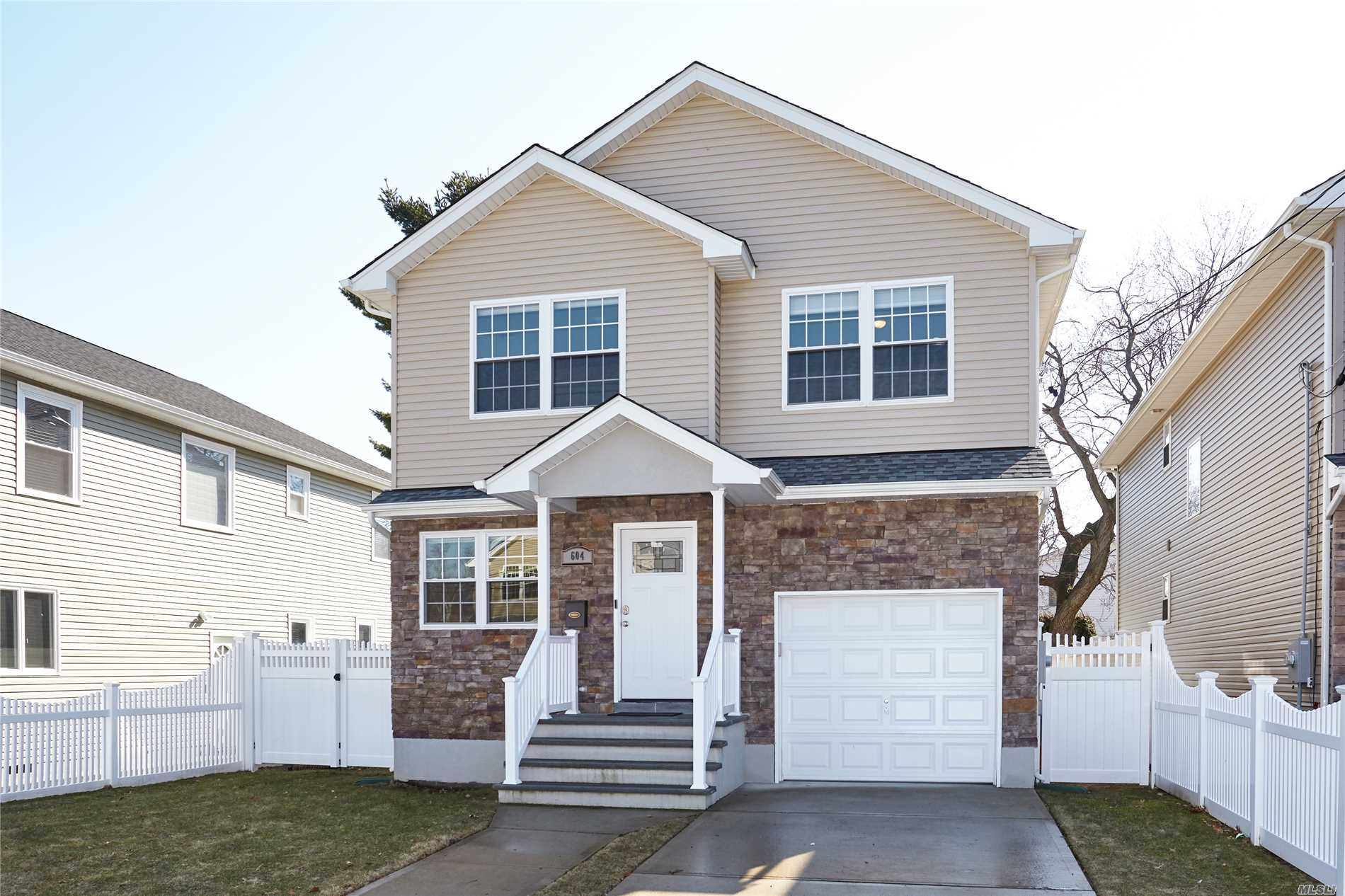 Awesome 3 Year New Home, Large Eat-In Kitchen W/ Huge Island, Stainless Steel Appliances, Granite Counter Top, Large Lr, Additional Den Rm W/ Built-In Wall Fireplace, Formal Dining Rm, Large Master Suite W/ Full Bath + Walk-In Clst, 3 Large Bdrms, Full Bath, Huge Full Finished Basement W/ Laundry Rm, Rec Rm, Built-In Wine Cooler, Large Backyard, Garage + So Much More!!!!