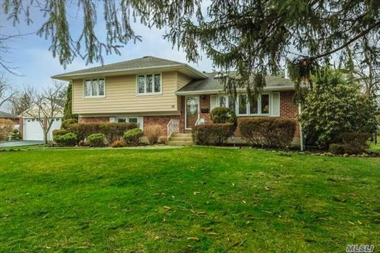 Beautiful Split W/Lrg 2 Car Det Garage Set On A Flat Fenced .5 Acre On Desirable Quiet Street!!New Central Air, 200Amp, Generator Hook Up, Newer Siding & Roof, Eik W/Granite And Ss Appliances. Gleaming Hardwood Floors. Master Bedrm W/Full Bath & 3 Additional Bedrooms, 3 Full Baths, Enjoy Sitting/Dining In Sunroom Overlooking Backyard.Crown Molding, New Wash/Dryer, Recessed Lighting, Raised Panel Interior Doors, Great Opportunity To Be In Renowned Commack School District!!