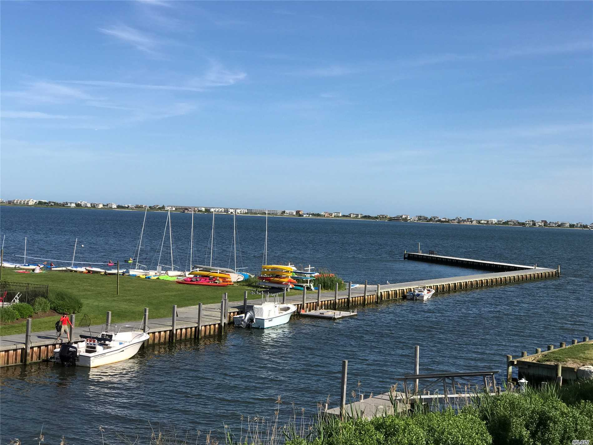 Amazing Water Views...Private Dock On Canal Leads To Moriches Bay. 100 Feet Of Bulk Heading. Views Of Moriches Bay Looking Over To Dune Road.  Great Home For Boating Enthusiasts Or Those Appreciating The Serenity Of Waterfront Property,  Low Taxes,  Gunite Pool And Expansive Deck. Potential For Making This Your Dream Home. Bring Your Builder Or Architect. Westhampton Beach And Remsenburg Schools. Rogers Beach Are Short Distance Away. Sunrise In The Morning. Spectacular Sunsets!