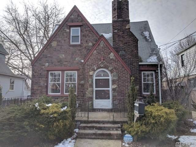 Charming Brick Tudor Cape With Eye Catching Curb Appeal. Needs A Lot Of Your Love And Care On The Inside To Bring It Back To Its Original Beauty! Ton's Of Potential To Be Your Dream Home! Come & See For Yourself!