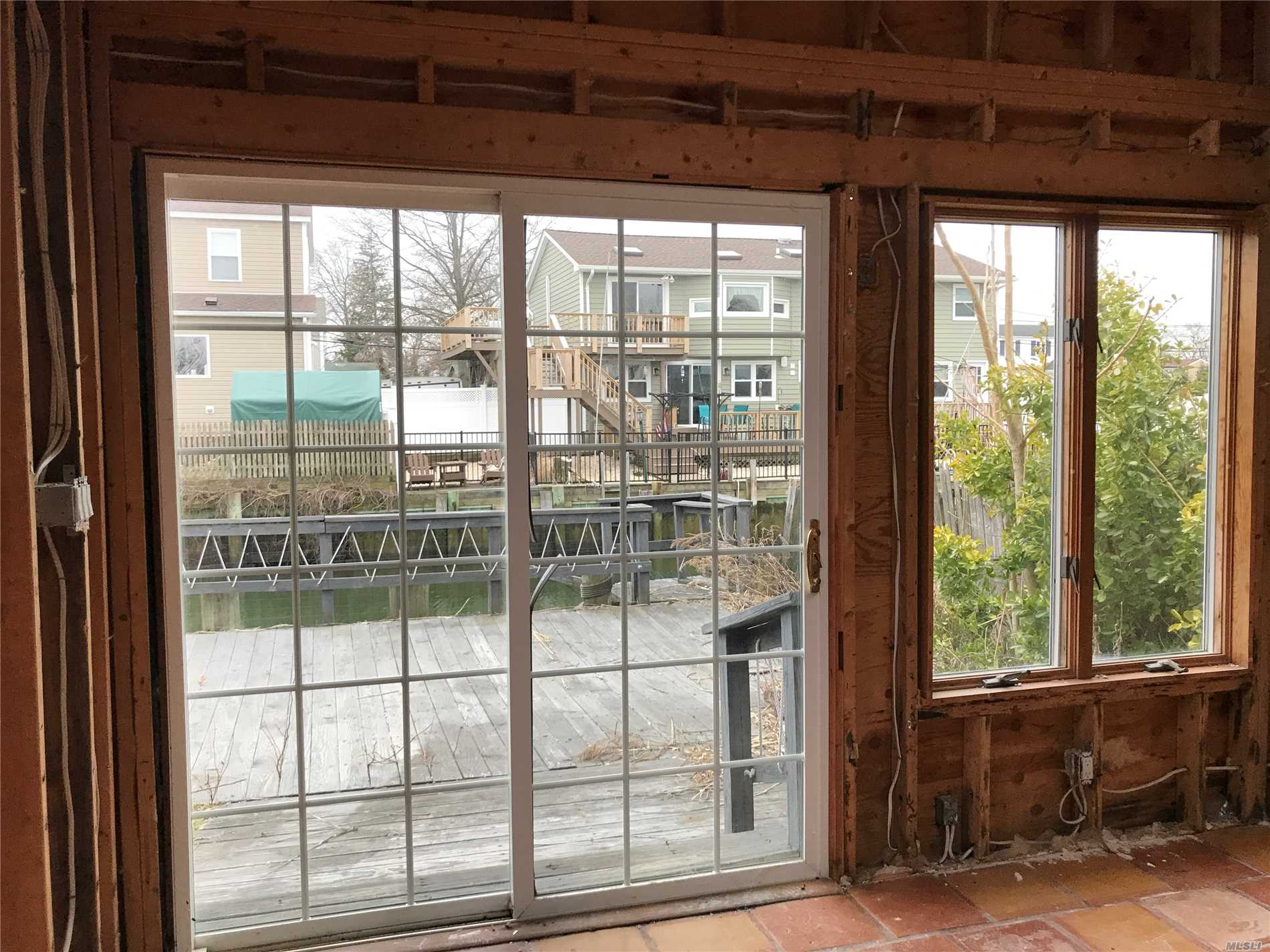 As-Is Water Front House With New Bulkhead. Including A Detached Separate 20X59 Parcel W/Garage & Driveway Across The Lane. This Home Is Completely Gutted On The First Floor Due To Water Damage From Sandy Cash Only. House Needs To Be Elevated, & Taxes May Change, Please Verify. So Many Possibilities. Investor's Delight On The Water. Take Your Boat Right Out To The Open Bay.