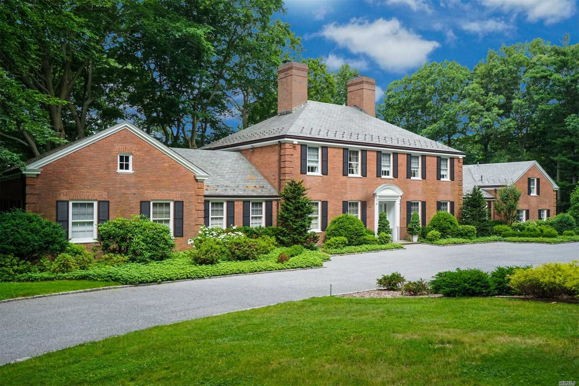 Traditional Custom Built 1968 Brick Manor Home Tucked Away On 5 Tranquil Mill Neck Acres With Pool. Long Driveway Leads To A 7 Bedroom House With Large Formal Entertaining Rooms Overlooking Spacious Patio. Cozy Paneled Library With Fireplace. First Floor Master Bedroom Suite. Attached 3 Car Garage Plus A 2 Car Detached Garage, Central Vac And Whole House Generator.