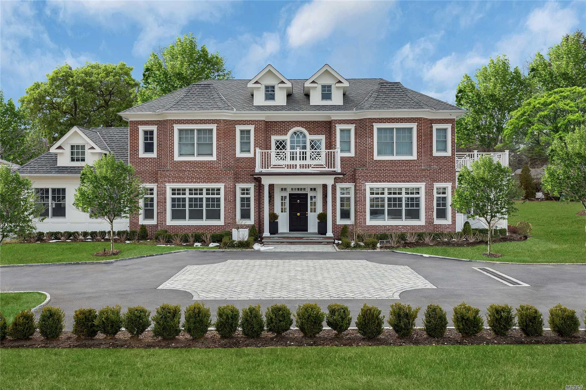 Old Westbury. Sophisticated & Elegant Brick Colonial. Set On A Private Rd In A Private Cul-De-Sac, Along With Two Other Exquisite Estates, On Almost 2 Acres. Featuring Impeccable Details Throughout With Flawless Finishes, Floor To Ceiling Marble Double Sided Fireplace, Refreshing Eik With White Cabinetry/Marble & Stainless Steel High End Appliances, Coffered Ceilings, & Much More!