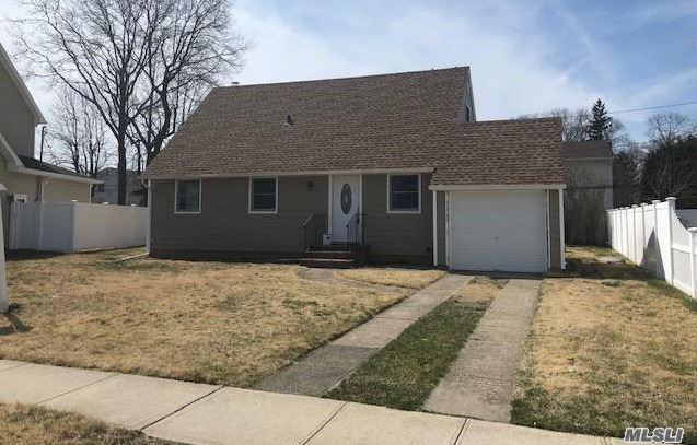 Beautiful Home Being Renovated On A Quiet Street-New Kitchen-New Bath-New Windows-Still Time To Pick Colors-Beautiful Hardwood Floors Throughout-Seaford Schools.