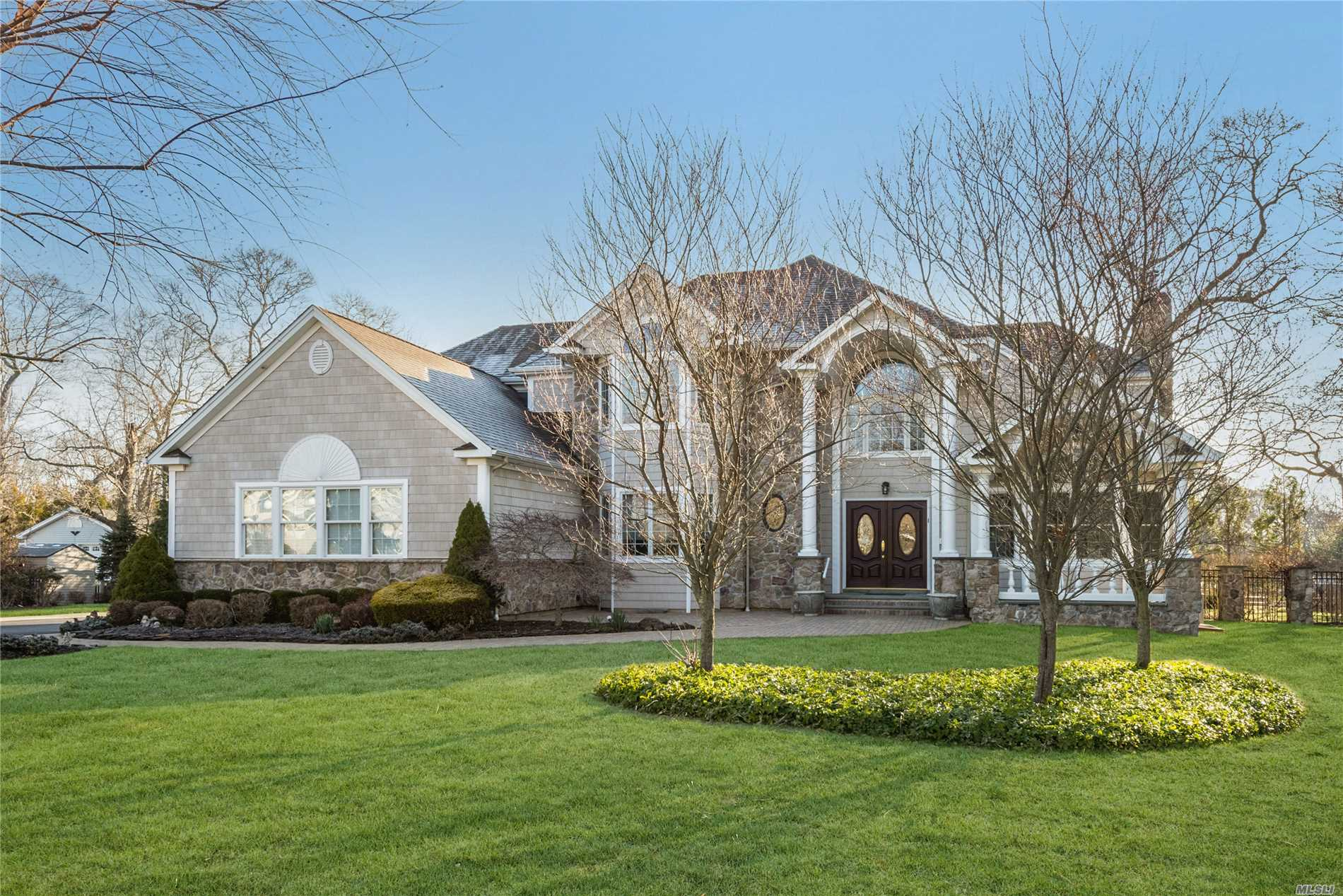 Spectacular 3600 Sq. Ft. Home In The Landings At Harts Cove W/5 Br, 3.5 Bths. Hw Floors, Radiant Heat Under Tile Floors, Custom Moldings, Elegant Kitchen, Fantastic Butler's Pantry Area, Luxurious Master Bedroom With Lavish Soaking Tub, 1st Floor Guestroom Or Possible Maid's Quarters, 900 Sq Ft Garage W/ Extra High Ceilings For Suv Parking. Outside Enjoy A Private Yet Lush Resort-Style Backyard: In-Ground Pool, Paver Patios, Multi-Level Seating Areas - In Other Words, The Perfect Paradise!