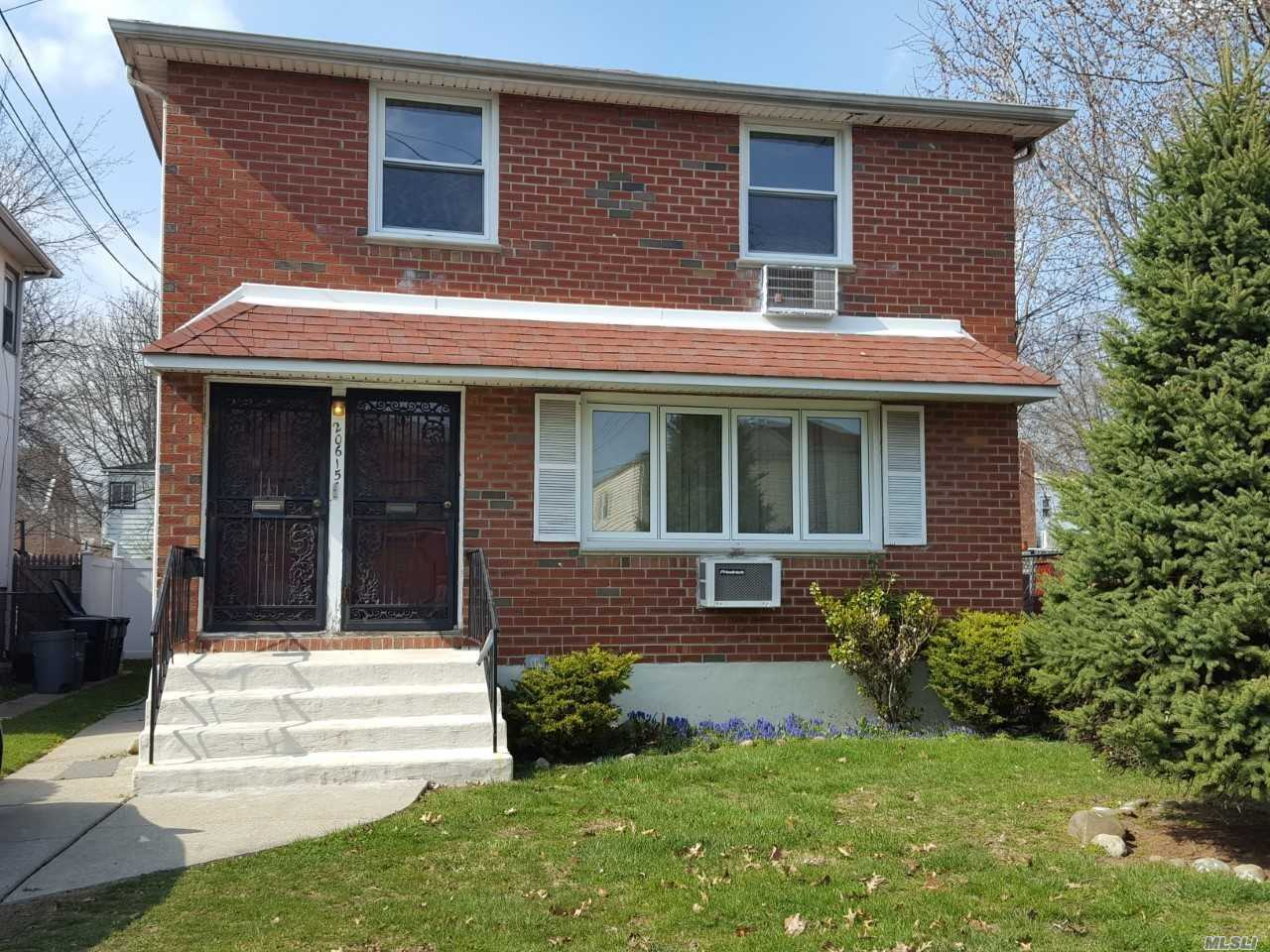 .Brick 2 Family Located In Bayside 6 Bedrooms 2 Full Bath With Finished Basement