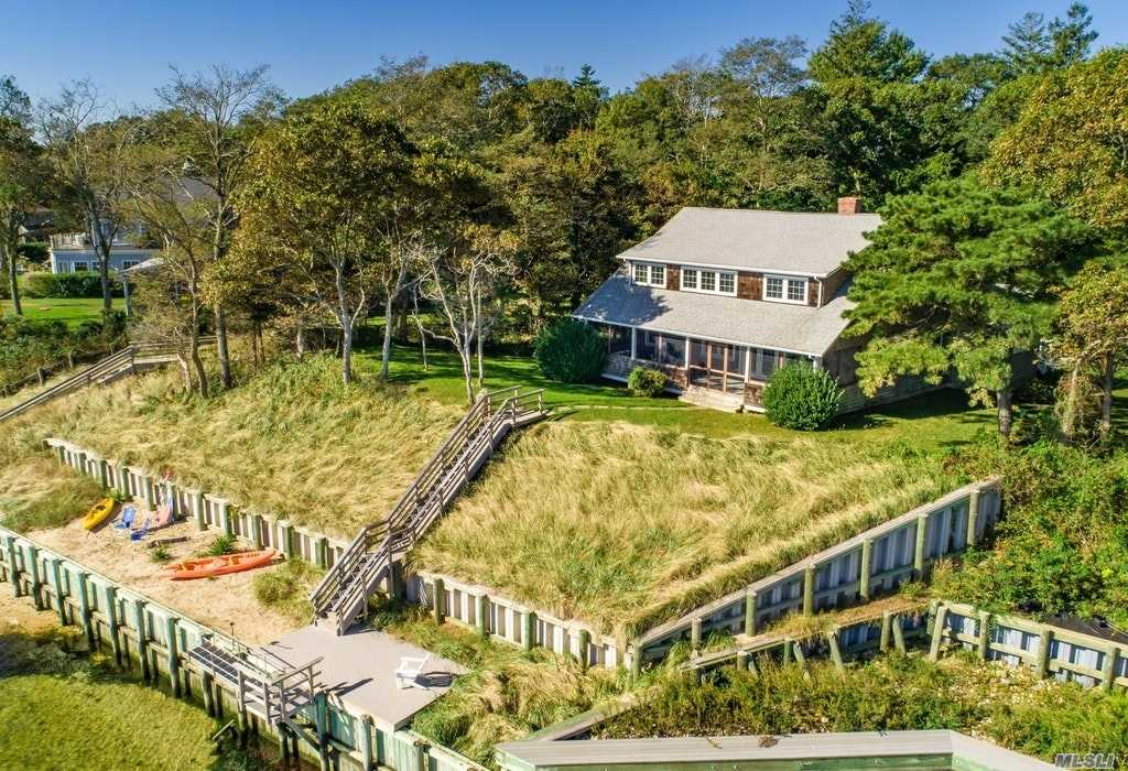 Quintessential Bayfront Craftsman ~ Set On 1.5 Acres, With Panoramic Views Of, And Access To, The Beautiful Great Peconic Bay, This Stately Jewel Elegantly Meshes The Charm Of The Past With The Ease Of The Present. Recently Renovated With An Open Concept Design, New Poured Concrete High Ceilinged Foundation, Heating/Central Air Conditioning And Electric, This 4 Bedroom, 3 Bath Cedarshake Classic Is A Magical Retreat!