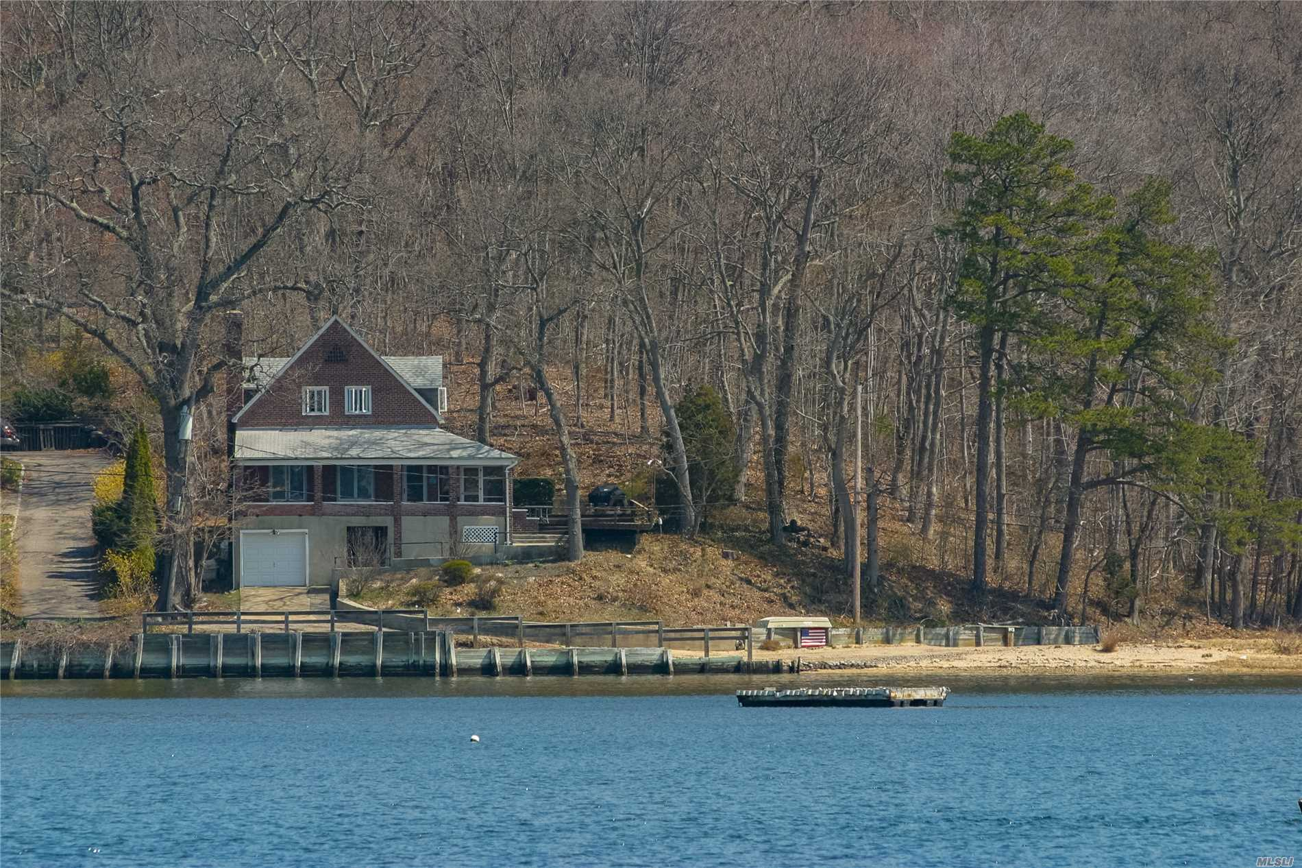 Rare Opportunity To Renovate/Expand/Build New Waterfront Home W/Panoramic Western Waterviews Of Centerport Harbor.  4-Bdrm House W/Well Water- Needs Tlc. Land Is 2 Lots Totaling 1.88 Ac With 280-Ft Of Waterfront And Beach. Not Subdividable.  *** Do Not Drive Thru Pillars At End Of Prospect Rd ***