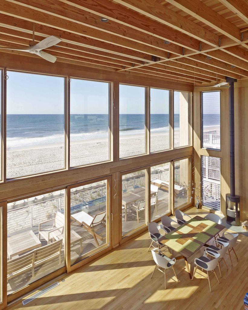 This modernist oceanfront beach house, designed by noted architect Eric Schiller, sits atop the crest of the dune on a high point of the Island, with spectacular views from every room. Located in the tranquil Dunewood community, this very special property is the retreat you've been waiting for. Constructed in 2015, the home features massive floor to ceiling glass, double-height living room and dining room, and an open floor plan to maximize flow. The expansiveness of the spaces blends the interior with the great outdoors. There are 3 comfortable bedrooms, with room to create a 4th, and 2½ baths. Watch the sunrises and sunsets from the upstairs den, which has panoramic views of both the ocean and the bay. <BR> <BR> The highest quality materials were used throughout the home, including clear red cedar interiors, hurricane rated windows, and yellow Alaskan cedar siding. The chef's kitchen boasts hand-selected Calacatta marble counters, top-shelf appliances including a SubZero refrigerator, Gaggenau induction cooktop, oven, and microwave drawer, and Miele dishwasher, and Vola faucet and sink spray. The Moreso wood burning stove in the main space sits atop a Pietra Cardosa hearth, and will keep you cozy when temperatures dip. The home is also equipped with central air conditioning and heating for your comfort. The Carrera marble bathrooms are luxuriously outfitted with Vola faucets and shower systems, custom sinks and Toto toilets, or you can head outside to utilize the large outdoor shower. Thoughtfully designed integrated storage spaces offer plenty of room to store your belongings. The deck in the front of the house can be fully shaded by the retractable custom Markilux motorized awnings. This exquisite home is one of a kind and is not to be missed!