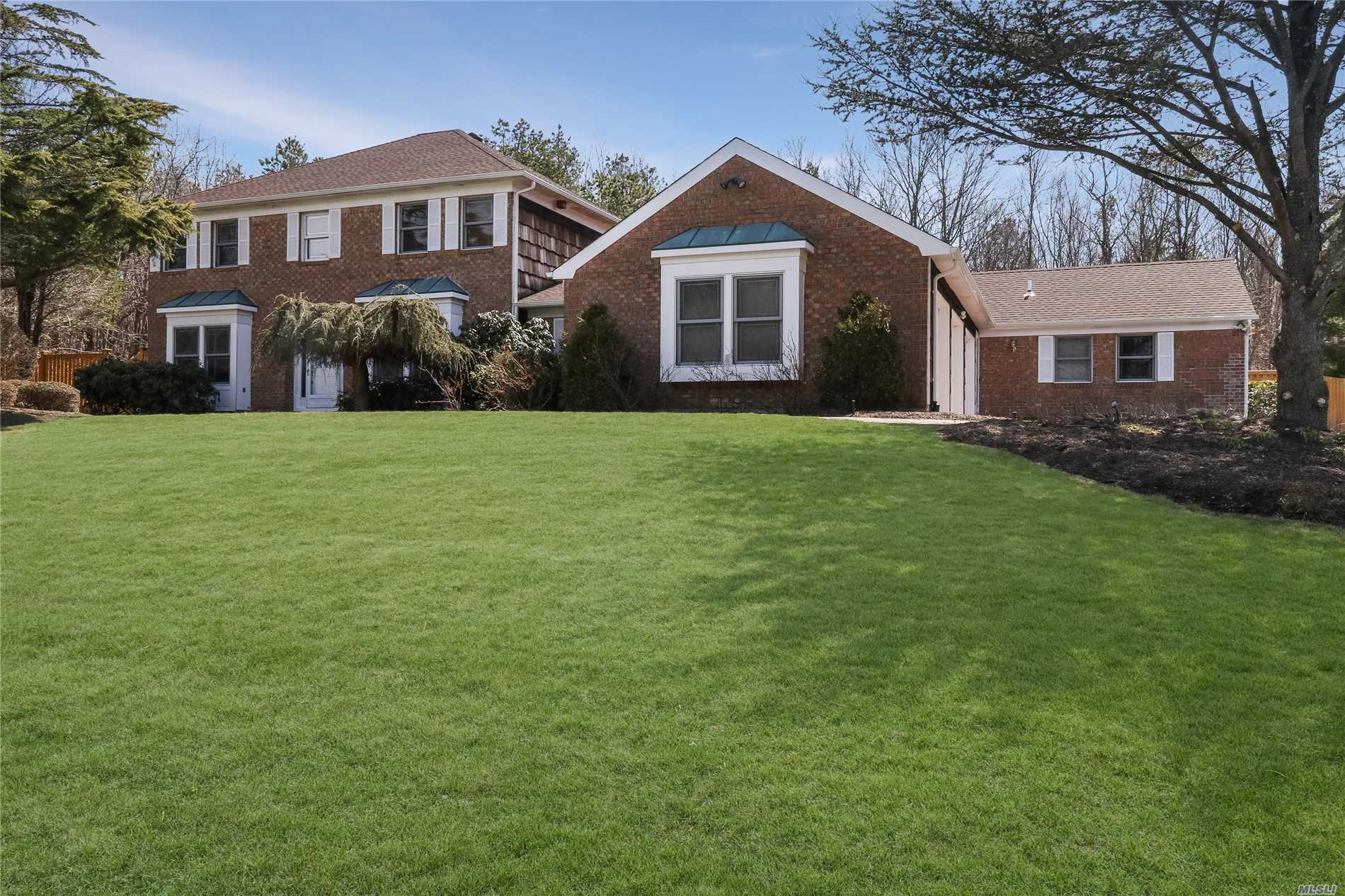 Luxurious 2 Family Style Living In This Updated Expansive Brick Faced 5 Bedroom Center Hall Colonial W/Rare 3 Car Garage, Diamond 3 Bedroom, 2 Bath Ranch Attached In The Prestigious Country Woods Development. Nestled On .60 Private Premium Lot Backing A Mature Oversized Treed Green Belt With Gorgeous Panoramic Scenic Park Like Views. Boasts A Country Club Fenced Yard With In Ground Pool, Cascading Rock Waterfall, Sprawling Paver Patio, Awning, Lush Landscaping And More!