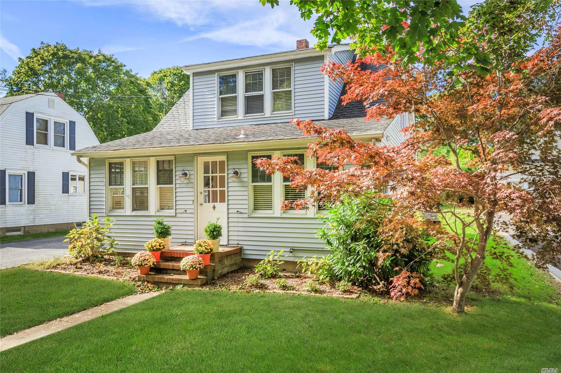 Wonderful 1940'S Cape In Sought After New Suffolk!! 3Br, 2Ba, Living Room, Formal Dining Room, Spacious Kitchen, Front Sun Porch, Full Basement, Area For Wine Cellar, Detached One Car Garage, Easily Maintained Property.