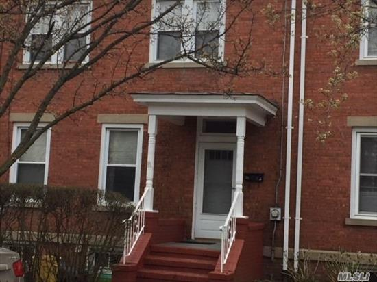 Excellent Mid-Block Brick Colonial Featuring 3 Brs, 2 Full Baths, Flr, Fdr, Full Unfinished Basement. Located In The Heart Of Town, Close To Transportation, Shopping, Schools, House Of Worship. All Amenities. Nice Yard, Gas Cooking And Heat. Walking Distance To Lirr.