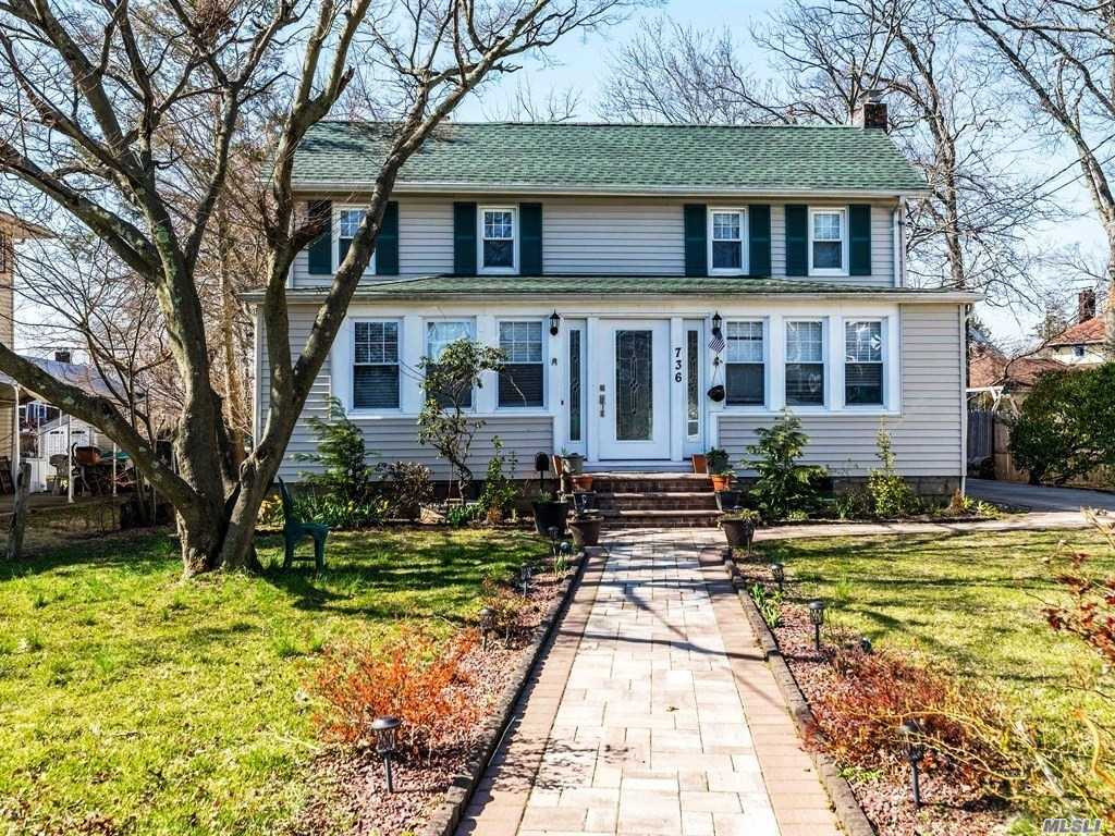 East Rockaway Colonial. 3 Bedrooms 2 Baths. All New: Granite Kitchen/Baths/Windows/Bamboo Floors/Gas Heat/Sheetrock Walls-Ceilings/Front Stoop-Pavers/L G Laundry. 200 A M P Electric. Living & Dining Room Fireplaces. One King & 2 Queen Bedrooms. 2 Lots Form 1/3 Acre L-Shaped Property. 3 Car Garage With Walk Up Loft & Cast Iron Stove. Tax Grievance Filed.
