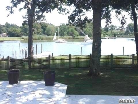 Cozy Up To The Wood Burning Fireplace While Gazing At The Waterfront Views From The Lr, Mbr Or Heated Sun Room In This 3 Br, 2 Bth Bulk-Headed (75') Water Front Home Ready For Boating & Summer Entertainment/Outdoor Activities W/ Floating Dock, Ramp And Multi-Level Decking - Fun For All! Cathedral Ceilings & Beadboard Detailing. Everything Updated Floor To Ceiling Including: Roof, Siding, Windows, Oil Tank, Heating, Cac, Wood Floors, Kitchen, Fireplace. Holiday Beach Amenities.