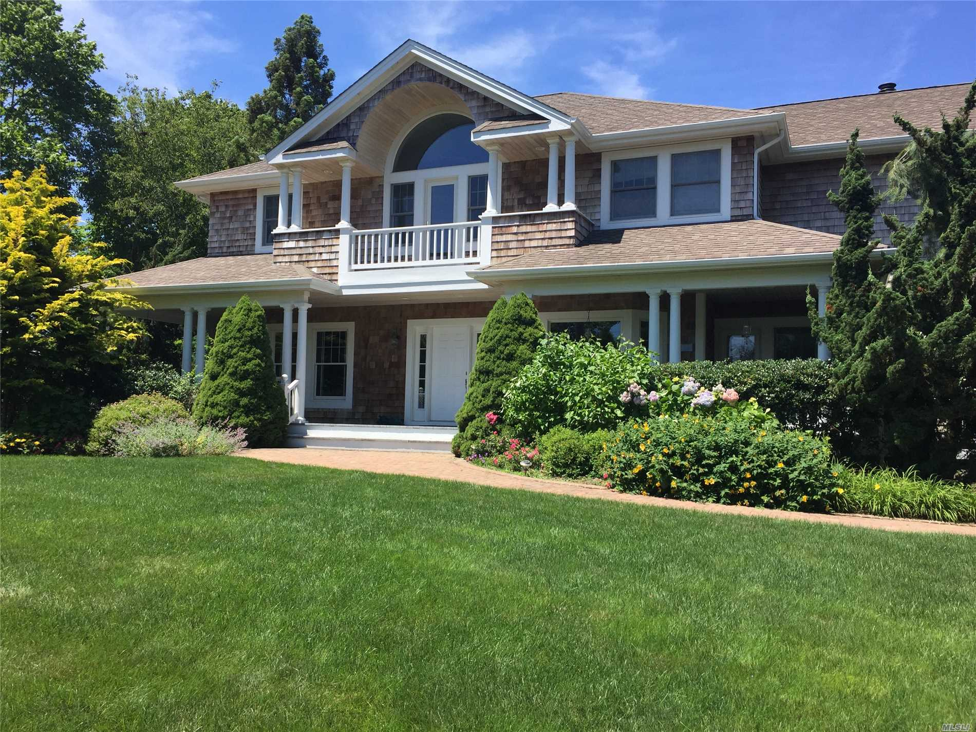 South Of Quogue St. This Lovely Light Filled Post Modern Home Offers Carefree Living In The Village. Open Floor Plan Includes A Centrally Located Kitchen Which Opens To The Living Room, Dining Room And Sun Room. Spacious Cedar Deck Overlooks An Expansive Lawn And Fenced Pool Surrounded By Mature Privet Hedges, Providing Privacy. Second Floor Includes A Spacious Master Suite With Two Additional Bedrooms, Baths And A Bonus Room For Additional Guests.