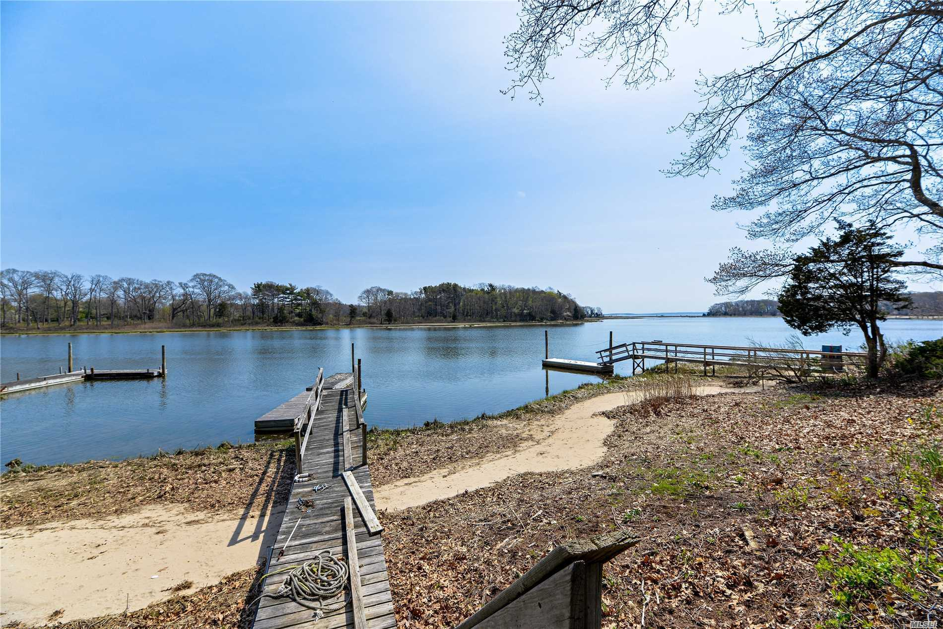 Location Says It All! 60'S Ranch, Waiting To Be Re-Imagined. 2 Bed. 1.5 Ba. 110 Feet Of Sandy Richmond Creek Front. Dock W/Deep Water Access To Peconic Bay. 2 Fireplaces. Hardwood Floors. Vast Views Of Mouth Of The Creek And Bay Beyond.