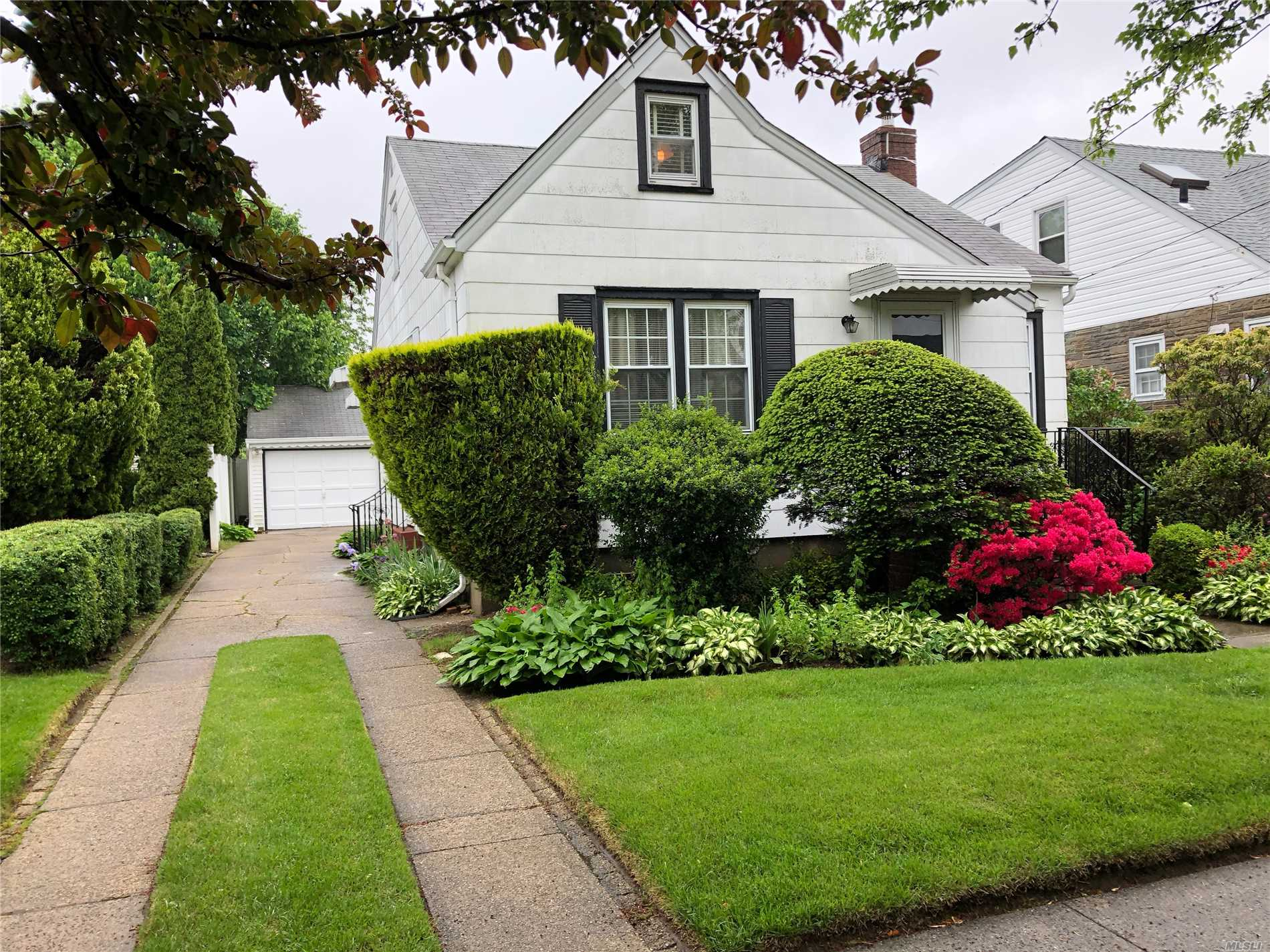Pride Of Ownership, Clean And Well Kept Mid Block Cape. 3 Large Bedrooms Plus Loft Sleep Area/Office Area/Nursery Area/Or Sitting Room Etc. 2 Car Garage! New Granite And Ss Appliances In Eik. Newly Redone Bath/Pedestal Sink. Hardwood Floors In 1st And 2nd Floor. New Pvc Fencing. Sd#5. Won't Last. A Must See.