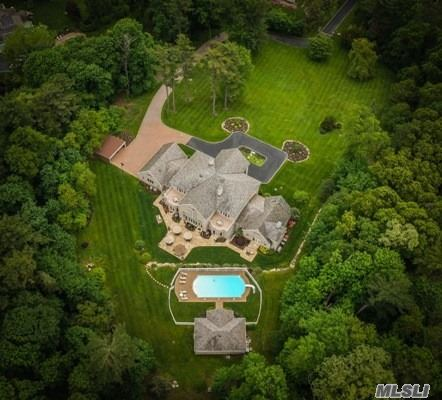 Spectacular Brick Estate Home On Shy 5 Lush Acres In Prestigious Muttontown. In-Ground Gunite Pool With Pool House, Open Space Living Room, Every Possible Amenity, Great Room With 36 Ft. Ceiling Height And Walls Of Glass Overlooking Breathtaking Grounds, Finished Basement, Gated Entry Provides Complete Privacy.