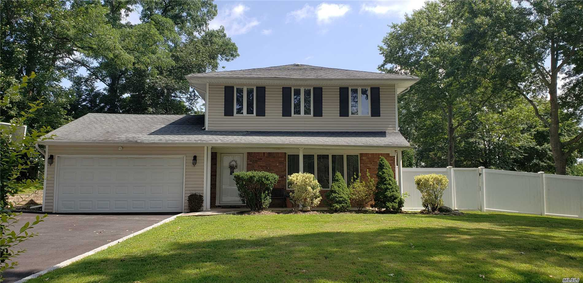 Wonderful Colonial Situated On A Flat Corner Lot With Plenty Of Room To Add A Pool! New Eik, Formal Lr & Dr, Large Den W/Vaulted Ceiling, Half Bath, Master Br Suite W/Private Bath, 3 Add'l Generously Sized Brs, Full Bath, Cac, Gas Heat & Cooking, 2 Car Attached Garage, New Driveway. This Home Is Spotless And Ready To Call Home!