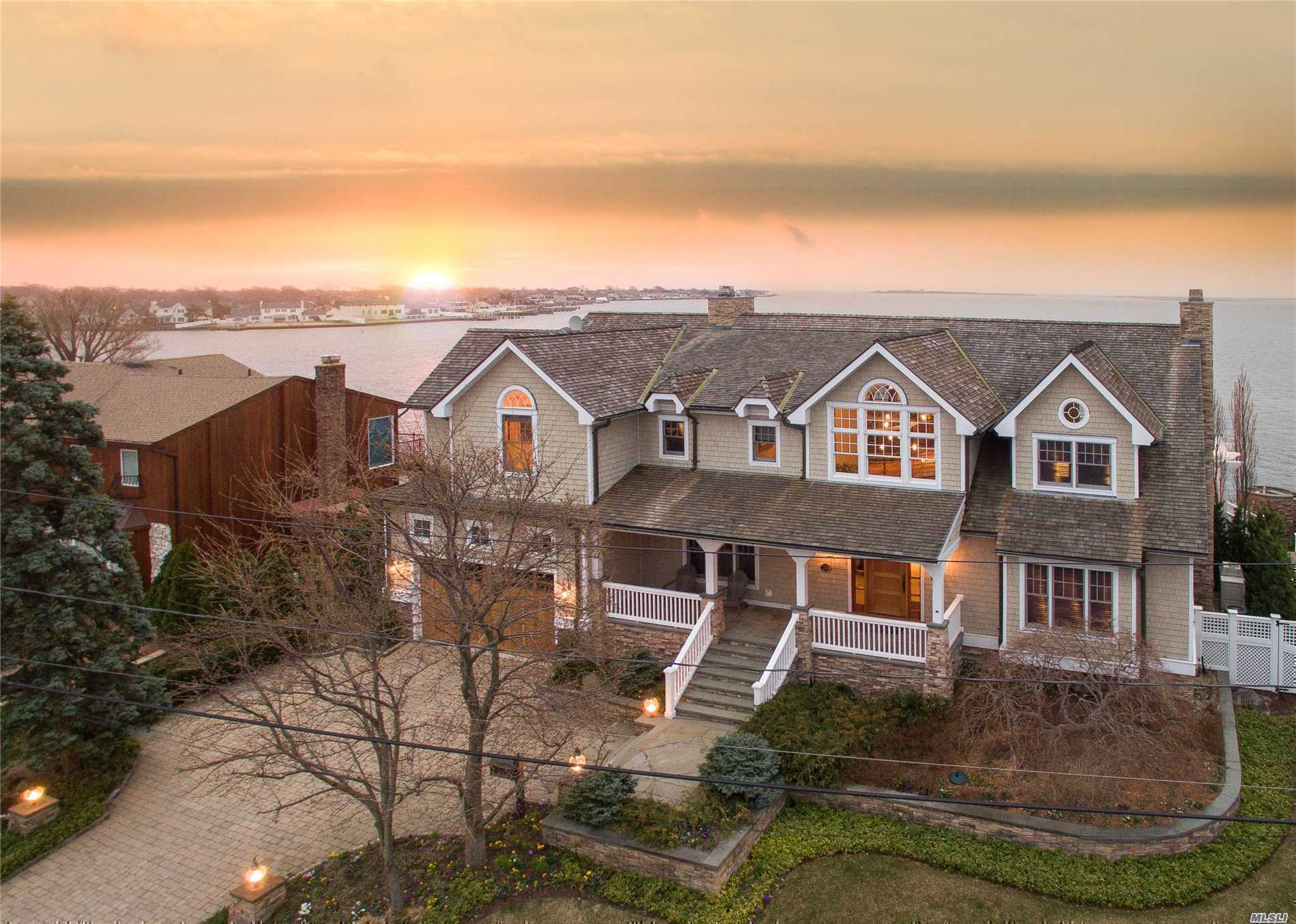 Summer Wind Is Impeccably Designed And Detailed For Effortless, Sophisticated Living By World-Famous Kean Development Company, This 5-Bedroom Waterfront Home Boasts Sweeping Views Of Great South Bay With Private Docking, Offering The Discerning Homeowner Move-In Ready Sanctuary Living. This Meticulously-Maintained Home Offers Effortless Entertaining Spaces.