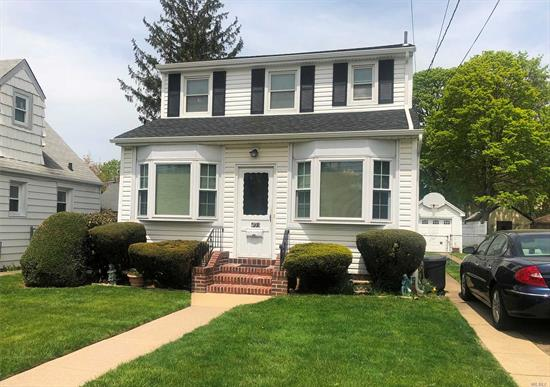 Bright Homespun Colonial On Quiet Street In Plaza School District. Minutes From Lirr. Bay Window Front Porch. Sunny, Wood-Paneled Den Adjoins Open Living & Dining Area. Beautifully Updated Eat-In Kitchen With Wood Cabinets, Granite Countertops & Stainless Appliances. Deep Yard. Full Length Driveway To Detached One-Car Garage.