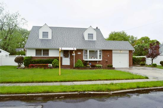 Nice Location For This Brick Cape With 4 Bedroom And Updates Including Windows, Roof, Heating System, Electric, Extended Den, & More. All This On An Over Sized Beautifully Landscaped Yard.