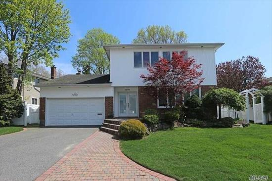 Recently Redone From Top To Bottom, This Light And Bright Colonial On Over-Sized Property Offers: Wood/Granite Eik W/Ss Appliances/Gas Cooking, New Frig, Sunken L/R W/Banded H/W Floors, Den W/Fplc & Sliders To Yard, All Redone Baths, H/W Thru-Out, Andersen Wdws, Surround Sound In/Out, Hi-Hats, Cable Ready In Every Room, Alarm, Pavers, Prof. Landscaped, Pvc Fence, Sump Pump, French Drain, Flood Zone X. Just Pack And Move In!!